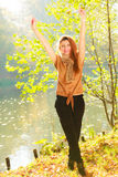 Young girl in forest. Woman posing in front of park river. Nature relax fashion beauty concept Royalty Free Stock Photos