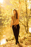 Young girl in forest. Woman posing in front of park river. Nature relax vintage fashion beauty concept Royalty Free Stock Photos