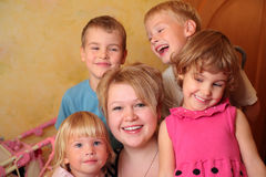 Young girl and four children Stock Images
