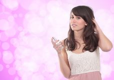 Young girl with fresh perfume Royalty Free Stock Image