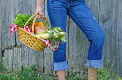 Young girl with fresh vegetables Stock Photo
