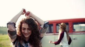 Young girl with friends on a roadtrip through countryside, dancing. Slow motion stock video