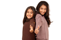 Young girl friends standing back to back Royalty Free Stock Photography