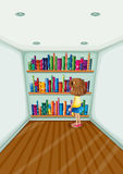 A young girl in front of the bookshelves with books Royalty Free Stock Image