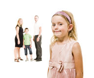 Young Girl in front of her family Stock Photography