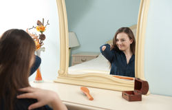 Young girl in front of mirror Royalty Free Stock Photo
