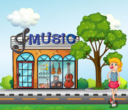 A young girl in front of the music store Stock Images