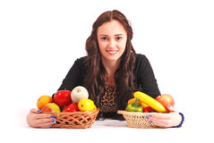 Young girl with a fruit basket Stock Image