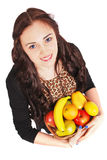 Young girl with a fruit basket Royalty Free Stock Images