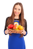 Young girl with a fruit basket Stock Photography