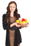 Young girl with a fruit basket Royalty Free Stock Photos
