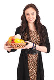 Young girl with a fruit basket Stock Photos
