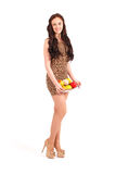 Young girl with fruit gathered in her dress Royalty Free Stock Images