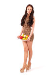 Young girl with fruit gathered in her dress Royalty Free Stock Photos