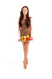 Young girl with fruit gathered in her dress Stock Image