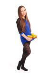 Young girl with fruit gathered in her dress Royalty Free Stock Photo