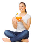 Young girl with fruit salad Stock Images