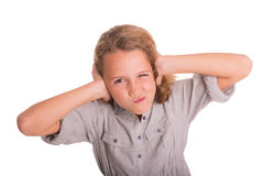 Young girl frustrated by noise. Child is frustrated by the noise and does not want to listen stock image
