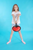 Young girl with a frying pan Stock Photo