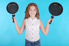 Young girl with a frying pan Stock Photography