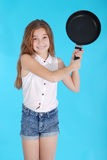 Young girl with a frying pan Royalty Free Stock Photo