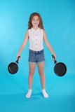 Young girl with a frying pan Stock Image