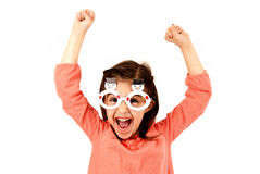 Young girl in fun winter glasses with excited expression Stock Photography