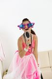 Young girl with funny glasses singing Royalty Free Stock Photo
