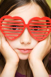 Young girl with funny sunglasses Royalty Free Stock Image