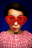 Young girl with funny sunglasses. Portrait of young girl with funny sunglasses Stock Photography