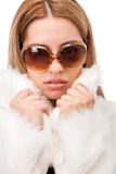Young girl with fur Stock Images