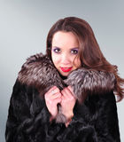 Young girl in a fur  coat Stock Photo