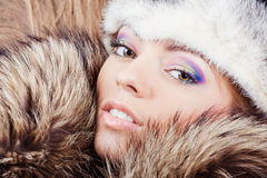Young girl in fur hat Royalty Free Stock Photos
