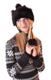 Young girl in a fur hat Royalty Free Stock Images