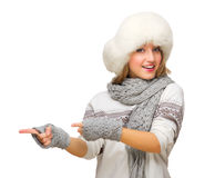 Young girl with fur hat showing pointing background Royalty Free Stock Images