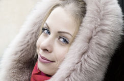Young girl in a fur hood Royalty Free Stock Photo