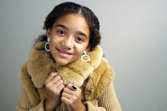 Young girl in fur jacket Stock Images