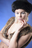 Young girl in fur vest Stock Photography