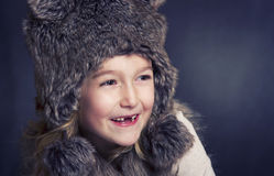 Young girl with fur winter ha Stock Images