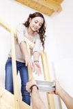 Young girl furnishes the new home Stock Images
