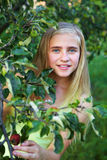Young girl in the garden Royalty Free Stock Photography