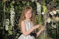 Young girl in a garden Royalty Free Stock Photography