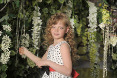 Young girl in a garden Royalty Free Stock Images