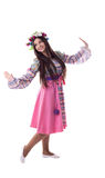 Young girl with garland dance in russian costume Royalty Free Stock Photo