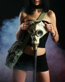 Young girl with gasmask Stock Image