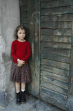 Young girl in gate with sad face, little bit fear,. Sad child on empty street in gate. Good pictures for charity organisations of children,life and lonely royalty free stock photos