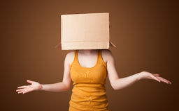Young girl gesturing with a cardboard box Royalty Free Stock Photography