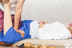Young Girl get Thai style massage by Woman for body therapy Stock Photo