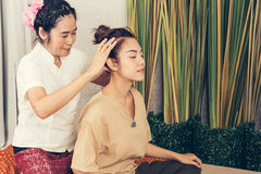 Young Girl get Thai style massage by Woman for body therapy Stock Image
