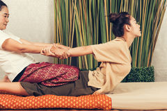 Young Girl get Thai style massage by Woman for body therapy Royalty Free Stock Photo